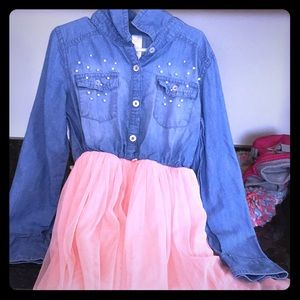 Jean top and a pink skirt